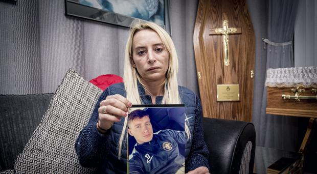 Gerard Thompson's mother Leanne holding a picture of him