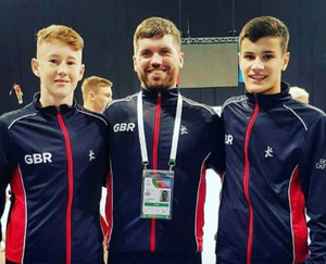 Simon Flanney (centre ) with gymnasts Ryan Devine and Fraser McLeod