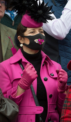 A racegoer at Cheltenham was quick to turn her face mask into a fashion accessory
