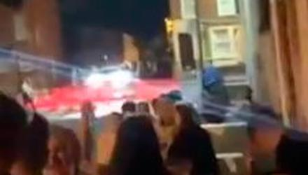 Footage of the street party in Belfast's Holyland area, showing PSNI officers in the background