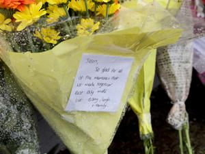 Flowers left outside the house in Orkney Drive, Ballymena, where he was stabbed to death