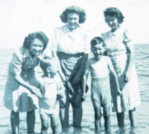 Ellie at the beach as a young woman