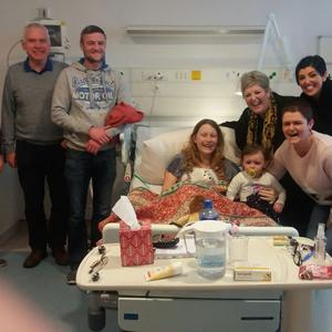 Karen with family and friends before she left for treatment