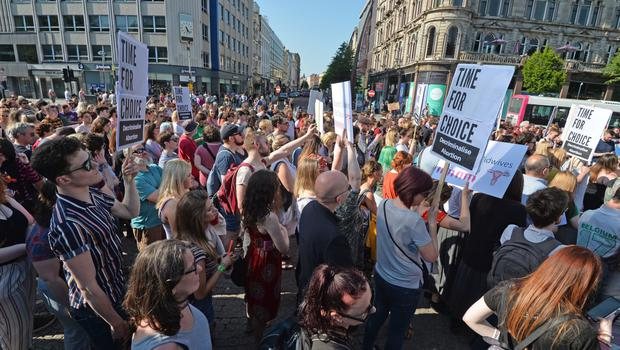 People attending a protest calling for the provision of abortion in Northern Ireland at Belfast City Hall yesterday