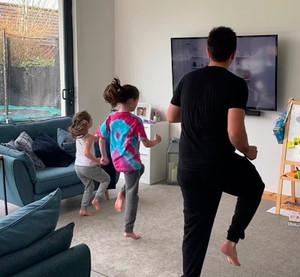 Keep fit: Pete Snodden and his daughters Ivana and Elayna with a Joe Wicks exercise video during the first lockdown