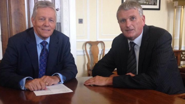 Jim Wells with former party leader Peter Robinson