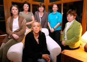 The sisters of murder victim Robert McCartney, Catherine, Donna, Paula, Claire and Gemma with his partner Bridgeen Hagans