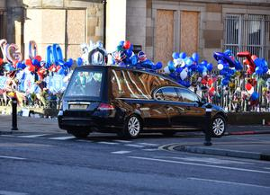 The body of murdered man Ian Ogle arrives back at his home in Cluan Place, east Belfast, yesterday