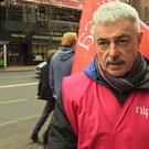 """Civil service pay in Northern Ireland is going """"backwards"""", striking workers said. Paddy McWilliams was among those who took action in Belfast (Michael McHugh/PA)."""