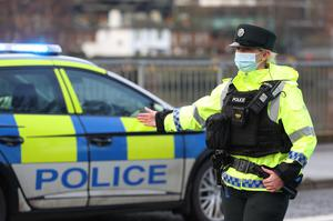PSNI officers during a vehicle checkpoint on the Ormeau Embankment in South Belfast on Tuesday (Liam McBurney/PA)