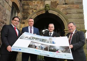 Mayor of Derry and Strabane, Councillor Maoliosa McHugh (right), Tom Reid, director, Transport Strategy, DFI, Gary McCluskey, Translink project manager, and Chris Conway, Translink group chief executive