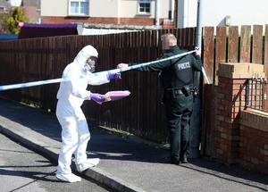 Police and forensics experts at the scene in Coalisland after the crossbow incident on Tuedsay