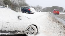 Cars stranded and crashed after skidding off the road in the Hightown Road area of Belfast