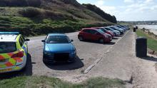 A photograph from the PSNI's Facebook page of cars parked on the north coast despite people being urged not to travel for exercise