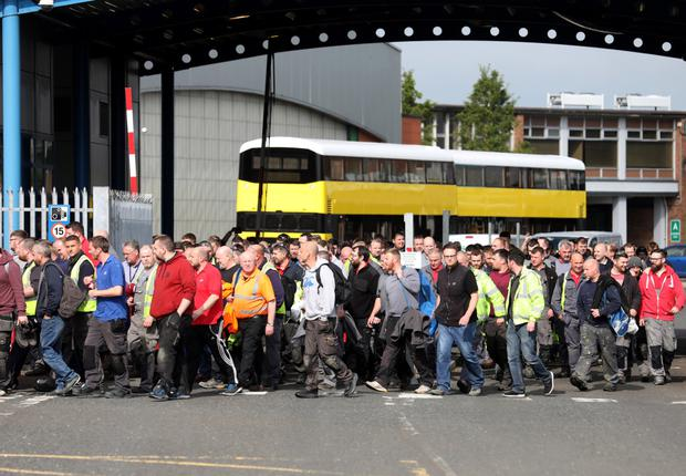 Hundreds of Wrightbus workers leave the factory in Ballymena on Wednesday