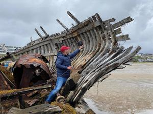 Shipwreck: Andrew McMaster from Retec Engineering conducts a scan of Bád Eddie