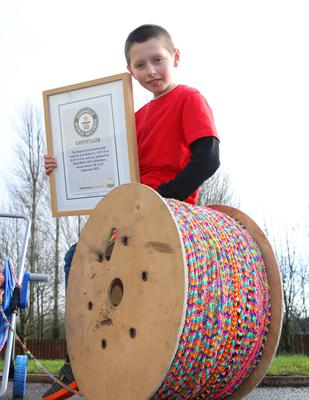 Mark Millar (10) from Broughshane with his Guinness Book of Records certificate