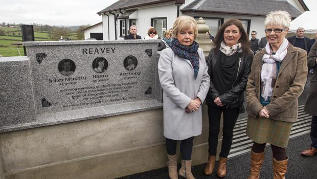 Sisters Cathy Michale, Colleen McKenna and Eileen Reavey unveil the monument to commemorate their brothers in Whitecross, Armagh