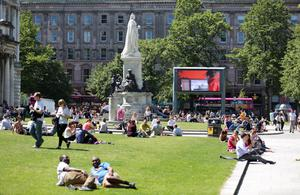 People soak up the sun at Belfast City Hall yesterday