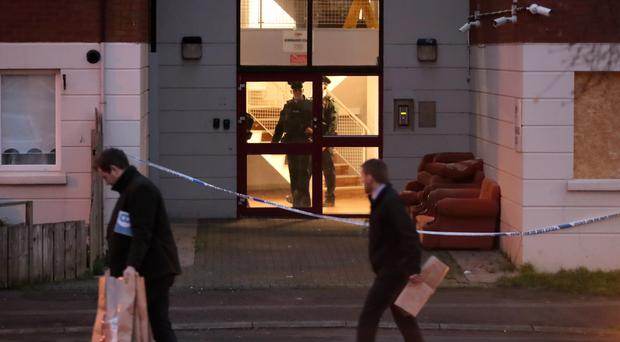The scene after two bodies were found in a Belfast flat (Liam McBurney/PA)