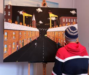 Belfast artist Foss at work on his 'Clap for Carers' painting