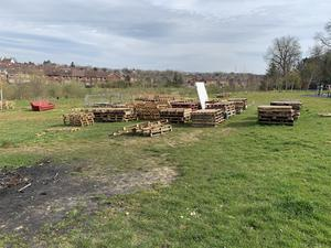 Bonfire builders stockpiling pallets in Orangefield Park in preparation for their annual 11th night bonfires