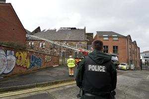 Attack: Police and firefighters at scene of arson