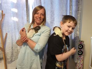 Leanne Reid with son Korey and two of their furry friends