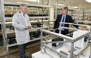 Brandon Lewis (left) chats to Randox's John Lamont during his visit to the business on Tuesday