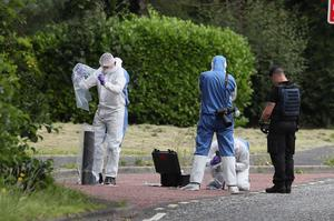 Investigators in Tullygally Road (Brian Lawless/PA)