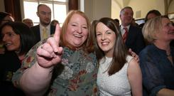 Alliance Party leader Naomi Long (left) celebrates with colleague Nuala McAllister