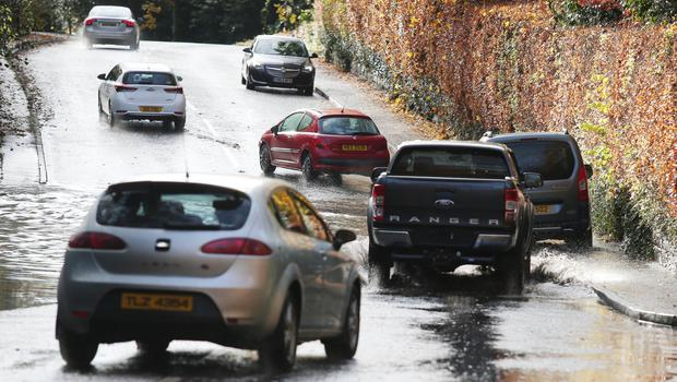 Cars faced flooding on the Upper Malone Road in Belfast