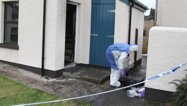 Forensic officers at the scene of the killing in Ballycastle
