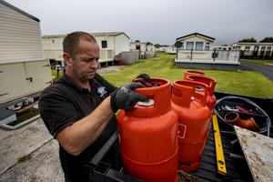 Paul Ferris, maintenance man at Sunnyholme Caravan Park in Newcastle Co. Down delivering gas as the ark prepares to reopen on Friday 26 June as lockdown eases in Northern Ireland. PA Photo. Picture date: Monday June 22, 2020. See PA story ULSTER Coronavirus. Photo credit should read: Liam McBurney/PA Wire