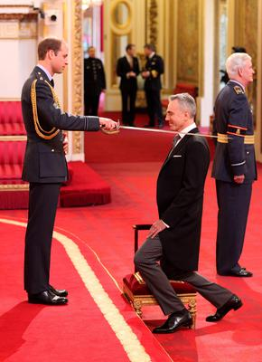 Sir Daniel Day-Lewis is made a Knight Bachelor of the British Empire by the Duke of Cambridge during an investiture ceremony at Buckingham Palace, London