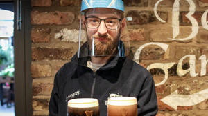 Bar supervisor Jamie Devlin at the Thirsty Goat in Belfast gets ready for reopening