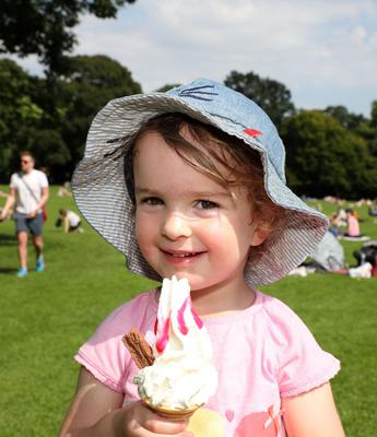 Little Lucy McBurney from Belfast enjoys a delicious 99