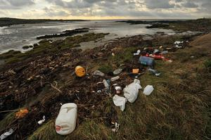 Debris and litter on the beach near St John's Point at Killough in Co Down