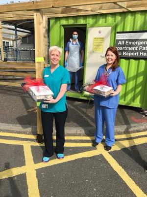Health staff yesterday with the tray-bakes rustled up by the female inmates of Hydebank Wood