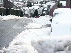 26.03.13. PICTURE BY DAVID FITZGERALD  The snow has forced people into abandoning cars and clearing the roads and their driveways as it has not thawed. Windermere Park in Four Winds, Belfast