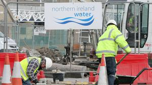 Workmen at a Northern Ireland Water project (Paul Faith/PA)