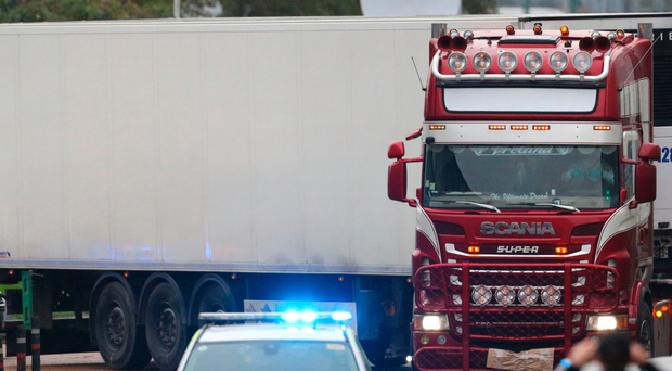 The container lorry where 39 people were found dead inside leaves Waterglade Industrial Park in Grays, Essex, heading towards Tilbury Docks under police escort