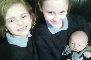Laura and Zara Collins with their new brother Daniel