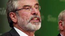 Sinn Fein party leader Gerry Adams speaks to the media in West Belfast (AP)