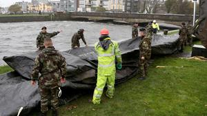 Flood barriers are readied in Galway City in preparation for the arrival of Storm Brian