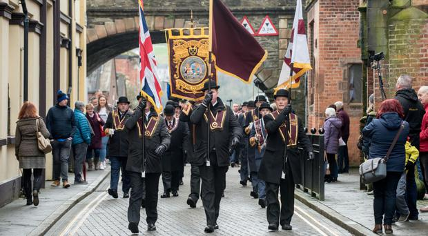 The effigy of Lundy is burnt as members of the Apprentice Boys of Derry make their way through the city centre on Saturday