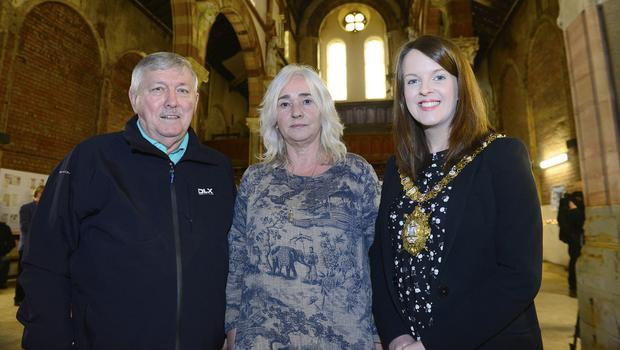 The Lord Mayor of Belfast, Nuala McAllister with Paddy Benson and Terry McKeown from Sailortown Regeneration Group look around the renovated St Joseph's Church