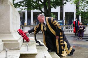 Belfast, Alderman Frank McCoubrey, lays a wreath at the Cenotaph at Belfast City Hall
