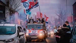 Rangers fans celebrate the team's win on the Shankill Road early yesterday afternoon