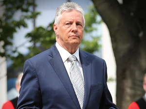 Peter Robinson (pictured) has threatened legal action over the contents of a tweet by the Irish independent TD Mick Wallace